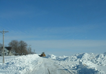 A loader removing snow from a road