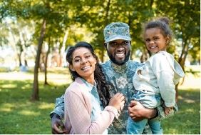 Image of a military service member and his family